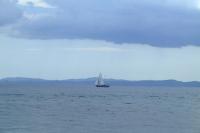 Small sailboat in Corfu Channel