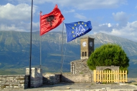 Flags of Albania and Gjirokaster Castle, Albania